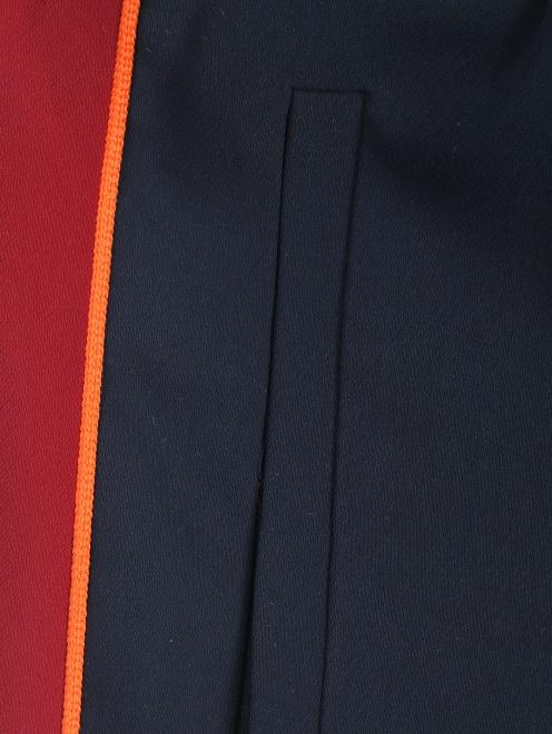 Спортивные брюки на резинке с лампасами - Деталь1